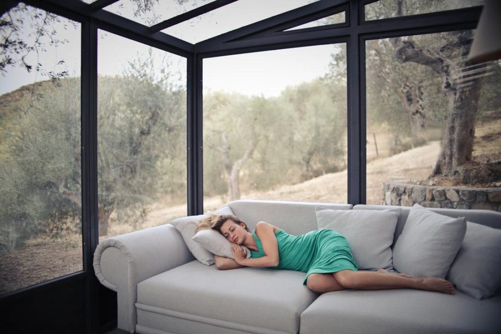 Woman sleeping on a sofa after using kratom