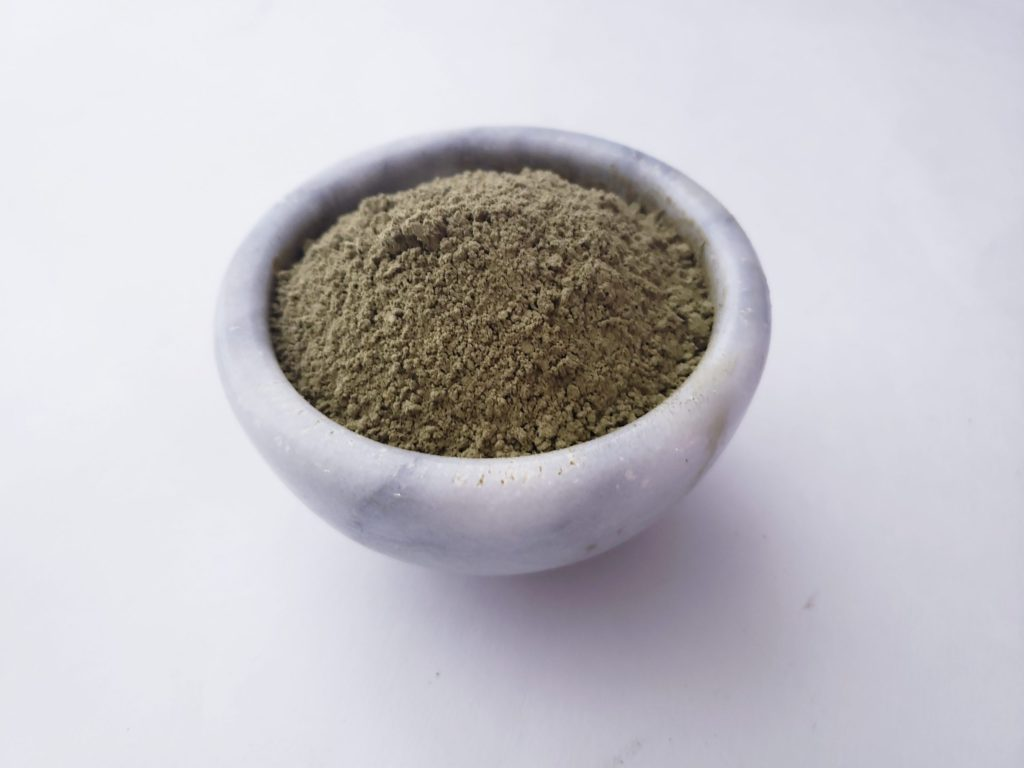 Kratom powder in small marble bowl.