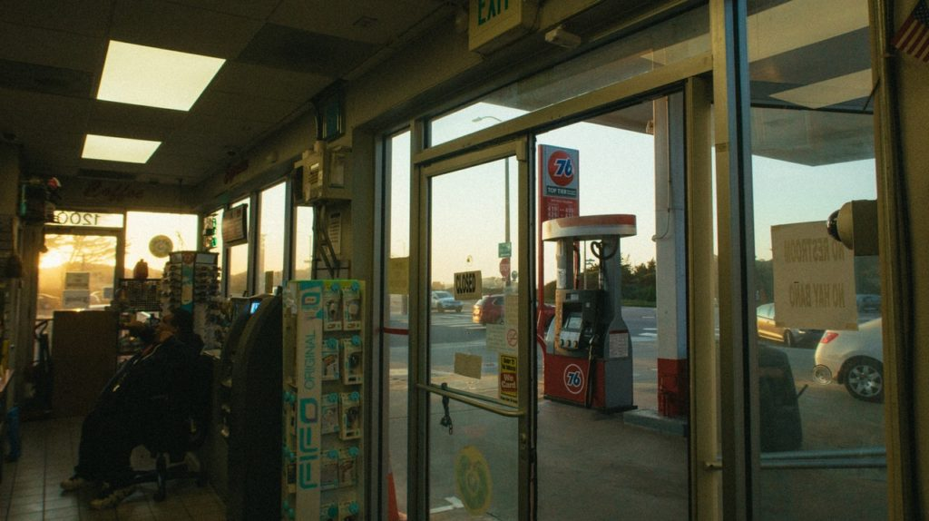 An image of a gas station pump from inside the gas station store.